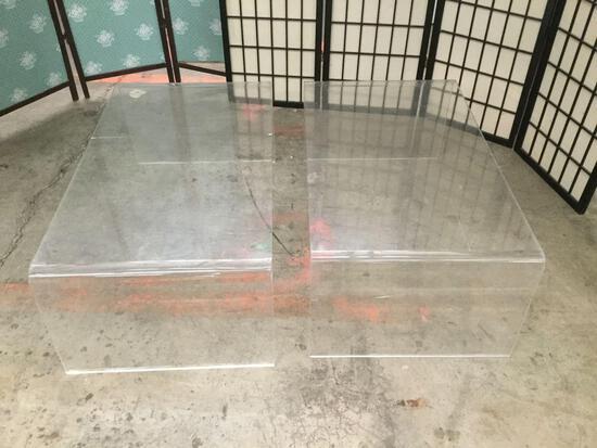 Pair of plexiglass tables.