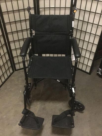 Probasics black folding wheel chair w/ foot rests, looks unused