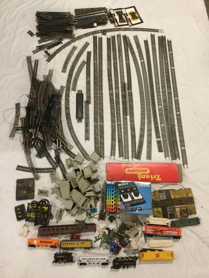 Collection of HO scale model train tracks, train cars, MRC Model Train Controller and accessories
