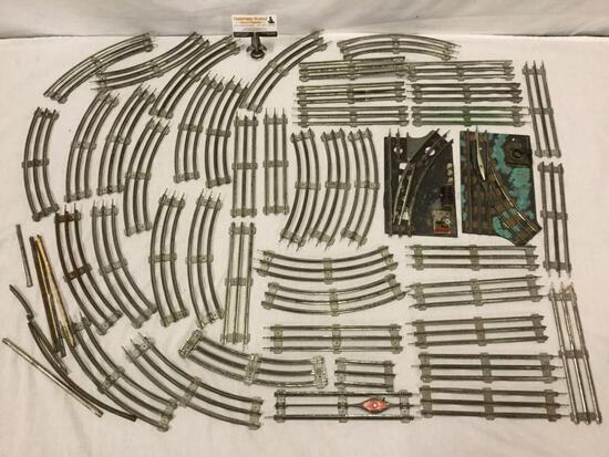 Collection of model train tracks with switcher and transformer base