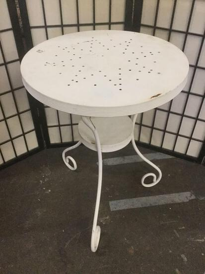 Vintage white metal round patio / cafe table, approximately 26x20x20 inches.