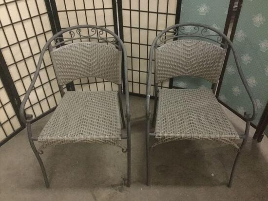 Pair of matching patio chairs with metal frame & woven seats