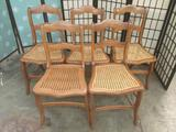 Lot of five matching wood chairs w/ woven wicker seats