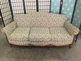 Vintage couch w/ floral upholstery & regal claw foot legs