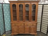 Large two-piece curio cabinet w/ 3-shelves, 2-drawers, & interior lights