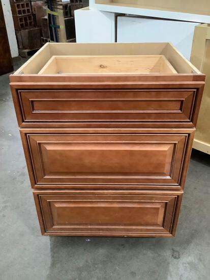 J&K Cabinetry 3 drawer kitchen or bath cabinet w/ no top, approx. 24 x 22 x 33 inches. Sold as is.