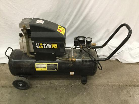 Central Pneumatic air compressor. Tested and powers on. Approx 40x24x14 inches.
