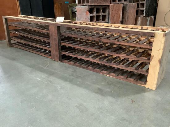 Large World Market wooden wine rack, shows wear, sold as is, approx. 86 x 17 x 12 inches.