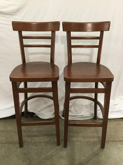 Pair of matching wooden bar chairs. Approx 43x16x16 inches.