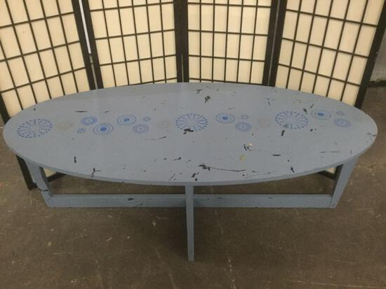 Vintage coffee table, painted blue. Approx. 55x26x18 inches. Sold as is.