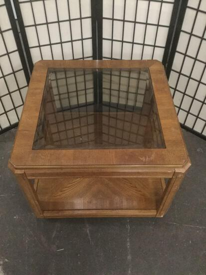 Vintage glass top coffee table, shows wear.