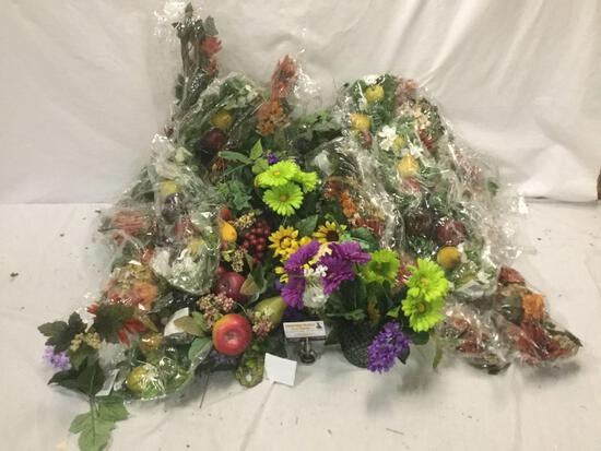 Large collection of faux flower and fruit arrangements