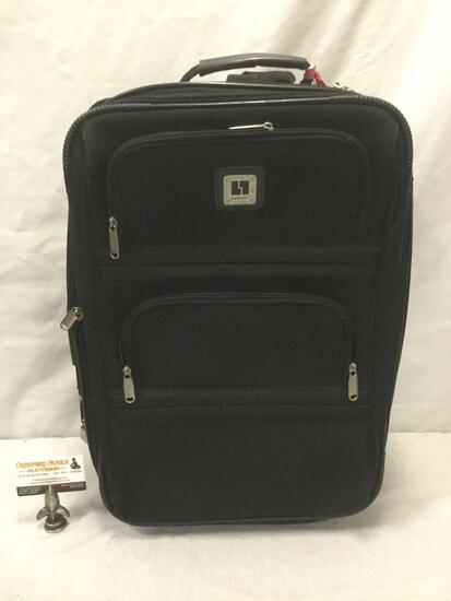 Black Leisure brand suitcase luggage piece with wheels.