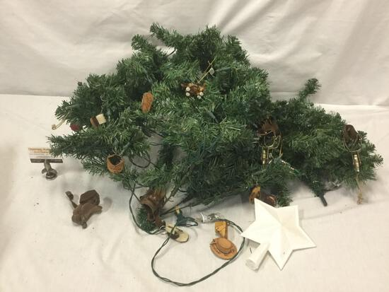 Lot of western themed ornaments attached to faux Christmas tree pieces