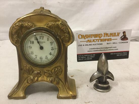 Ornate vintage brass New Haven brand clock. Approx 6x4x2 inches.