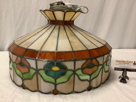 Stained glass hanging chandelier light fixture with floral theme.