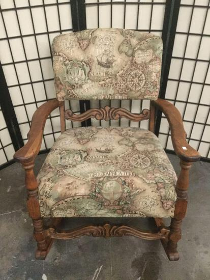 Wood carved rocking chair w/ geographical map design upholstered seat & back