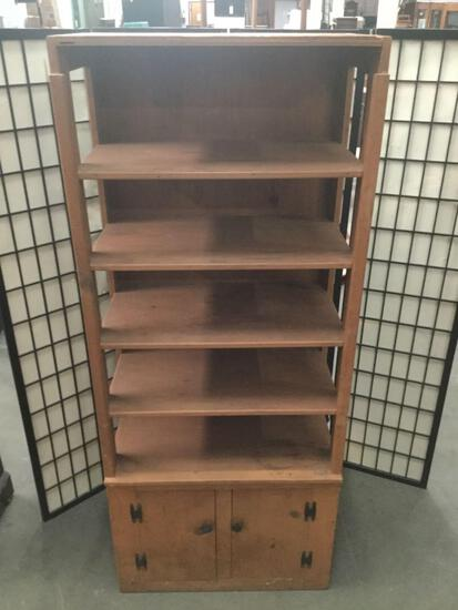 Vintage wooden bookshelf with lower cabinet, missing top trim piece