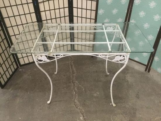 Vintage metal glass top patio table.