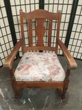 Vintage wood rocking chair with floral upholstered seat cushion