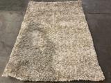 Dalyn Rug Company - Utopia shag carpet, approx. 60 x 88 inches.