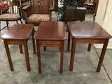 Lot of three matching wood side tables in three different sizes