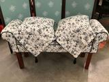 Black & white floral upholstered bench seat w/ 2 pillows, approximately 41 x 12 x 22 in.