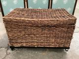 Modern woven wicker storage trunk, shows wear, approximately 30 x 18 x 19 inches.