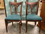 2 antique Tell City mahogany dinning chairs w/ green upholstered seats, shows heavy wear.