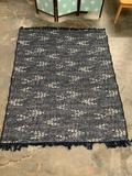 Threshold navy blue patio rug with fringe in good condition, approximately 60 x 81 inches.