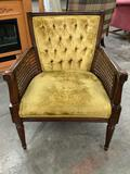 Vintage wood arm chair w/ woven wicker sides, upholstered seat/ back, shows wear