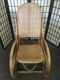 Vintage bamboo rocking chair w/ wicker seat and back, good condition.