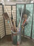 Collection of yard tools, shovels, takes, broom, and more