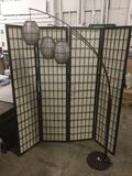 Standing lamp w/ 3 lights and woven/paper shades, shows minor wear. Tested & working