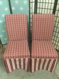 Pair of fully upholstered red and cream dining chairs