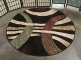 New City & Feraghan round rug w/ swirling abstract designs, approx. 63x63 inches.