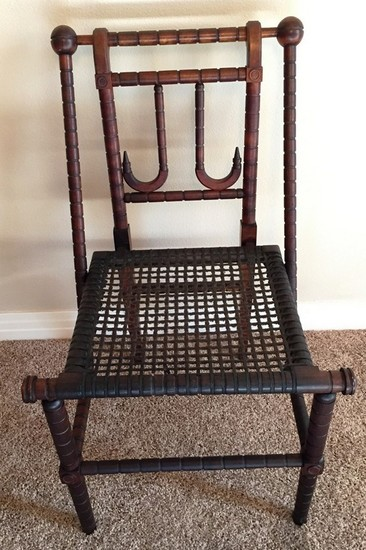 CARVED ANTIQUE SIDE CHAIR WITH CANE SEATING