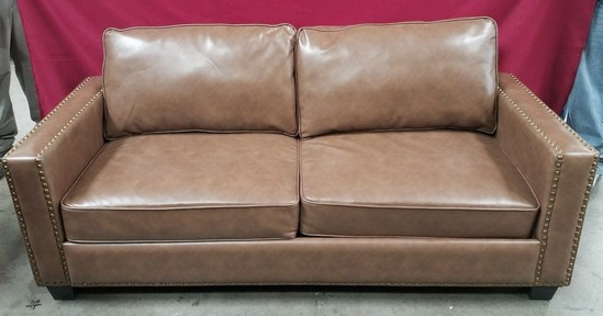 BRAND NEW LEATHER TAN SOFA FROM WORLD MARKET CENTER
