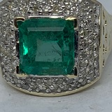 14KT YELLOW GOLD 4.00CTS EMERALD AND .50CTS DIAMOND RING