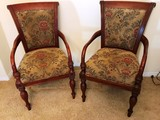 PAIR OF MAHOGANY FRAMED ARM CHAIRS W/ FLORAL PRINT