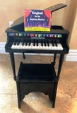 BLACK LACQUER CHILDS LEARNING PIANO FROM NEIMAN MARCUS