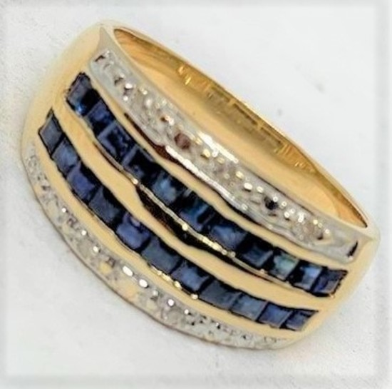 18KT YELLOW GOLD 1.10CTS BLUE SAPPHIRE AND .08CTS DIAMOND RING