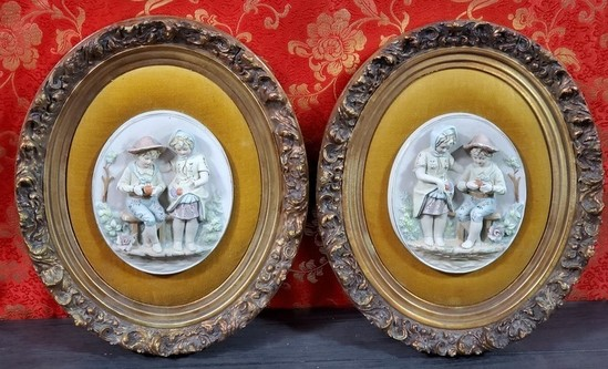 PAIR OF GOLD FRAMED PORCELAIN WALL DCOR - SEE PICS