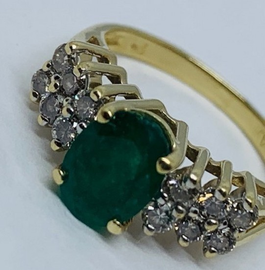 14KT YELLOW GOLD 2.00CTS EMERALD AND .55CTS DIAMOND RING