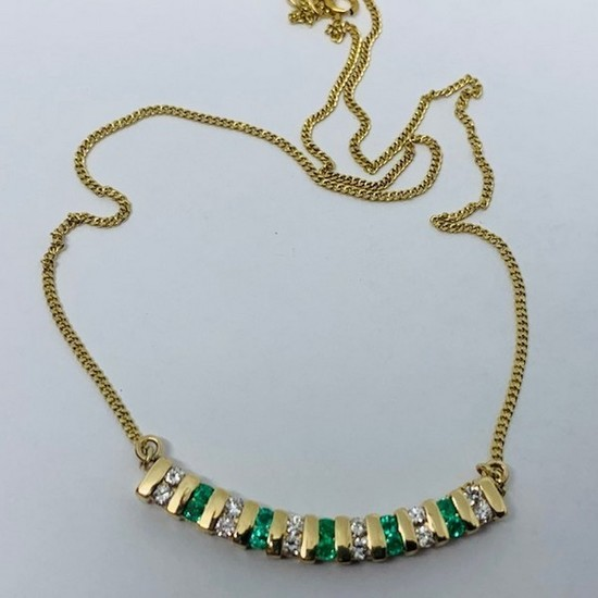 14KT YELLOW GOLD .55CTS EMERALD AND .75CTS DIAMOND NECKLACE