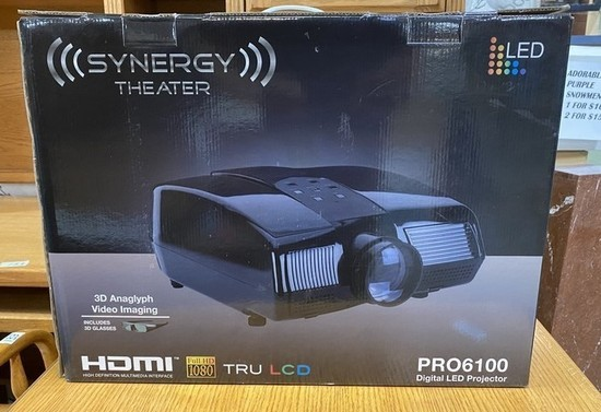 NEW IN BOX PROJECTOR BY SYNERGY.