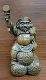 Chinese Bronze Figure - Man W/ Hammer In One Hand Sitting On Three Bales -