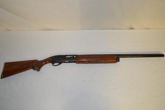 Gun. Remington Model 1100 12 ga Shotgun
