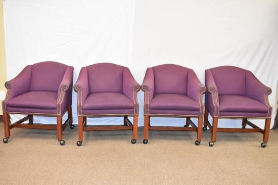 Four Upholstered Chairs on Casters