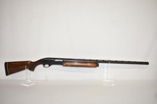 Gun. Remington Model 1100 Mag 12ga Shotgun